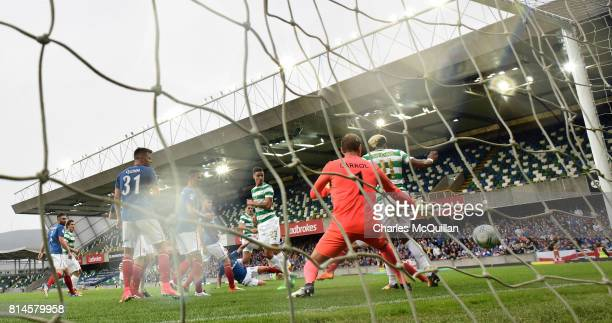 Tom Rogic of Celtic scores during the Champions League second round first leg qualifying game between Linfield and Celtic at Windsor Park on July 14...