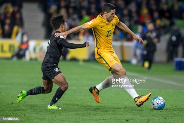 Tom Rogic of the Australian National Football Team and Nurul Sriyankem of the Thailand National Football Team contest the ball during the FIFA World...