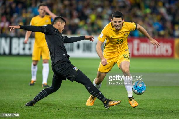 Tom Rogic of the Australian National Football Team and Pokklaw Anan of the Thailand National Football Team contest the ball during the FIFA World Cup...