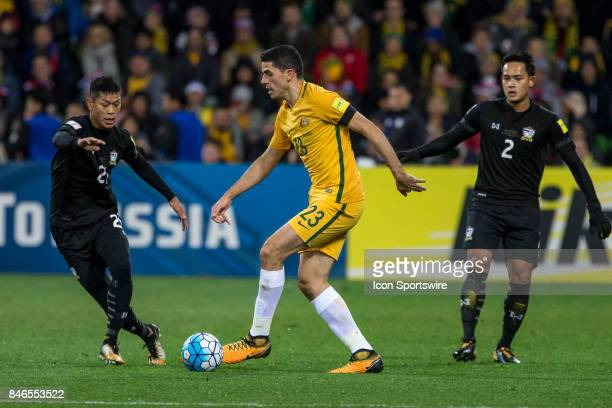 Tom Rogic of the Australian National Football Team looks for options in front of Pokklaw Anan of the Thailand National Football Team during the FIFA...
