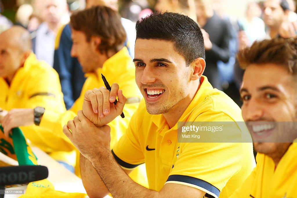 Tom Rogic signs autographs for fans during an Australian Socceroos public appearance at Westfield Sydney on November 12, 2013 in Sydney, Australia.