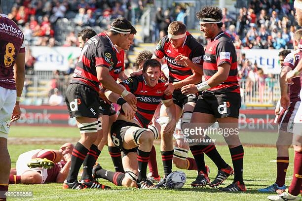 Tom Sanders of Canterbury celebrates with team mates after scoring a try during the round nine ITM Cup match between Canterbury and Southland at AMI...