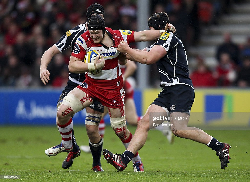 Tom Savage of Gloucester attempts to break free from the tackle of Ross Hamilton of Sale during the Aviva Premiership match between Gloucester and Sale Sharks at the Kingsholm Stadium on November 24, 2012 in Gloucester, England.