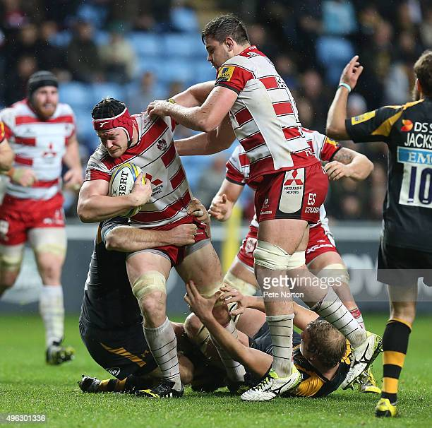 Tom Savage of Gloucester attempts to move forward with the ball during the Aviva Premiership match between Wasps and Gloucester at The Ricoh Arena on...
