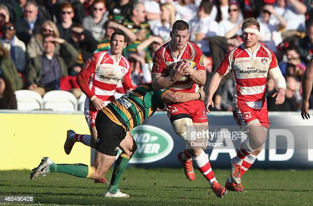Tom Savage of Gloucester breaks with the ball during the Aviva Premiership match between Gloucester and Northampton Saints at Kingsholm Stadium on...