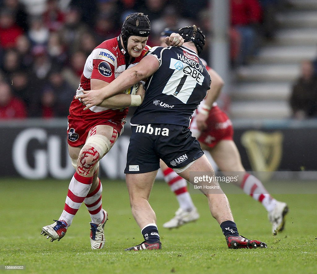 Tom Savage of Gloucester is tackled by Ross Harrison of Sale during the Aviva Premiership match between Gloucester and Sale Sharks at the Kingsholm Stadium on November 24, 2012 in Gloucester, England.
