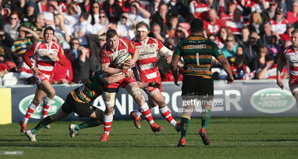 <a gi-track='captionPersonalityLinkClicked' href=/galleries/search?phrase=Tom+Savage+-+Rugby+Player&family=editorial&specificpeople=11374349 ng-click='$event.stopPropagation()'>Tom Savage</a> of Gloucester is tackled during the Aviva Premiership match Gloucester and Northampton Saints Kingsholm on March 7 2015 in Gloucester, England.