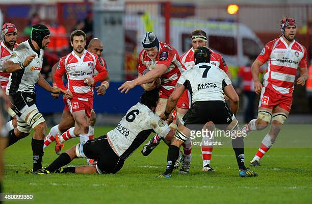 Tom Savage of Gloucester Rugby is tackled by Jacopo Sarto of Zebre during the European Rugby Challenge Cup match between Gloucester Rugby and Zebre...