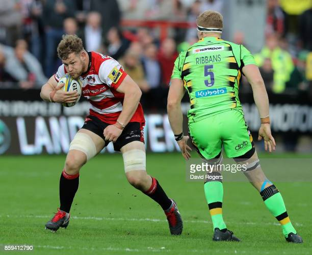 Tom Savage of Gloucester runs with the ball during the Aviva Premiership match between Gloucester Rugby and Northampton Saints at Kingsholm Stadium...