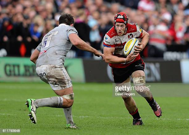 Tom Savage of Gloucester takes on Elliott Stooke during the Aviva Premiership match between Gloucester and Bath at Kingsholm Stadium on October 1...