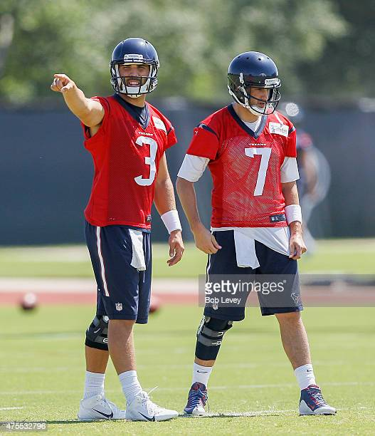 Tom Savage of the Houston Texans and Brian Hoyer work out during an NFL football organized team activity June 1 2015 in Houston Texas