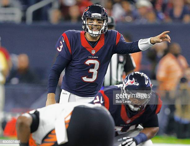 Tom Savage of the Houston Texans call out the play from the line of scrimmage against the Cincinnati Bengals at NRG Stadium on December 24 2016 in...
