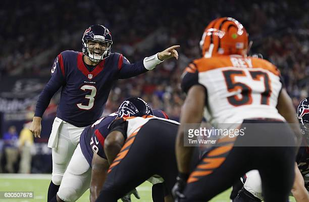 Tom Savage of the Houston Texans calls signals at the line of scrimmage against the Cincinnati Bengals in the third quarter at NRG Stadium on...