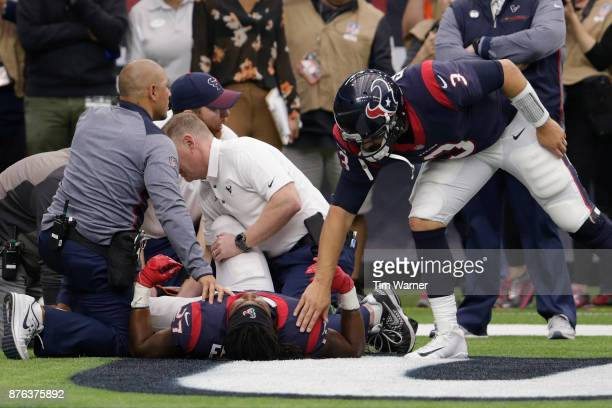 Tom Savage of the Houston Texans checks on D'Onta Foreman of the Houston Texans after an injury in the fourth quarter against the Arizona Cardinals...