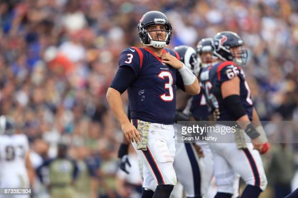 Tom Savage of the Houston Texans gets up after getting sacked during the game against the Los Angeles Rams at the Los Angeles Memorial Coliseum on...