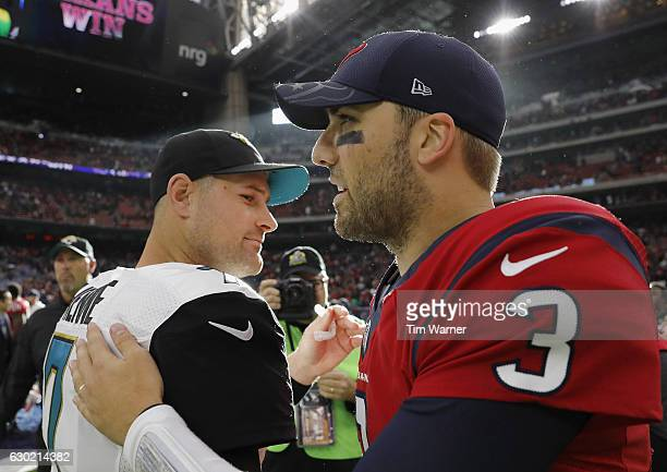 Tom Savage of the Houston Texans greets Chad Henne of the Jacksonville Jaguars after the game at NRG Stadium on December 18 2016 in Houston Texas