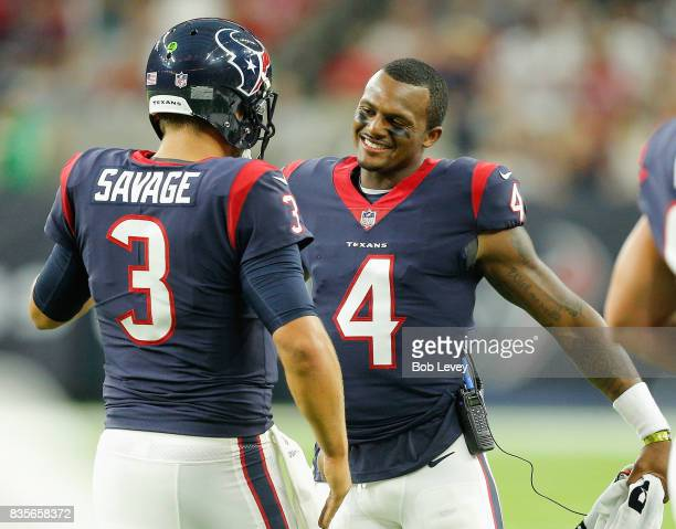 Tom Savage of the Houston Texans i congratulated by Deshaun Watson after throwin a touchdown pass in the first quarter at NRG Stadium on August 19...