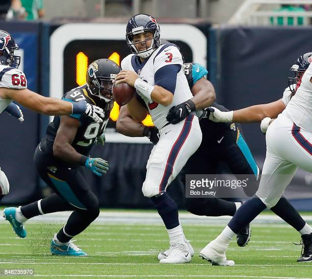 Tom Savage of the Houston Texans is sacked by Calais Campbell of the Jacksonville Jaguars and Malik Jackson at NRG Stadium on September 10 2017 in...