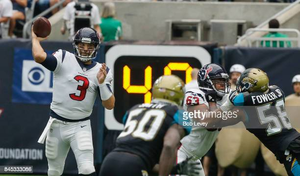 Tom Savage of the Houston Texans looks for a receiver in the second quarter against the Jacksonville Jaguars at NRG Stadium on September 10 2017 in...