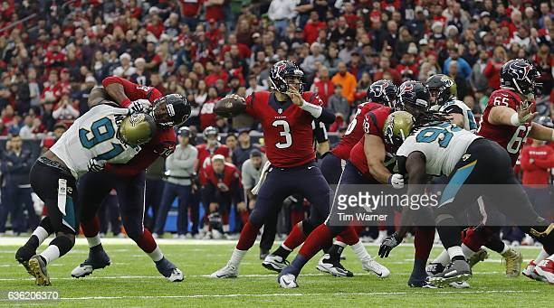 Tom Savage of the Houston Texans looks to pass as Chris Clark of the Houston Texans blocks Yannick Ngakoue of the Jacksonville Jaguars in the fourth...