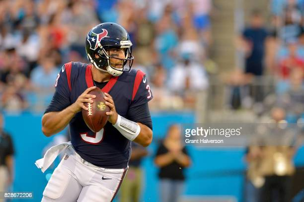 Tom Savage of the Houston Texans rolls out against the Carolina Panthers during the preseason game at Bank of America Stadium on August 9 2017 in...