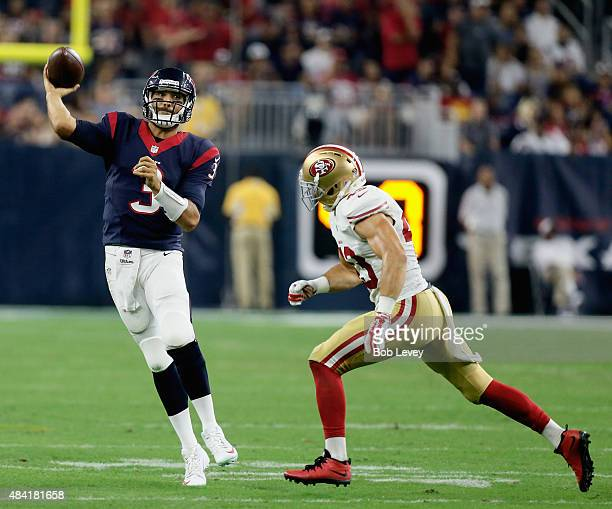 Tom Savage of the Houston Texans rolls out looking for a receiver as he is pursued by Craig Dahl of the San Francisco 49ers in the fourth quarter at...