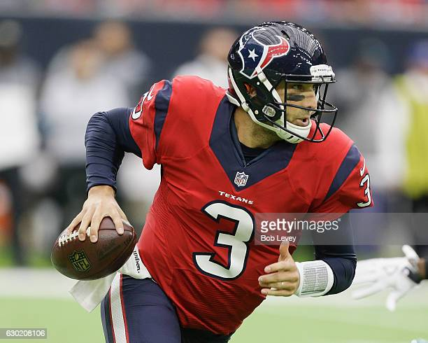 Tom Savage of the Houston Texans scrambles out of the pocket as he looks for a receiver in the second quarter against the Jacksonville Jaguars at NRG...
