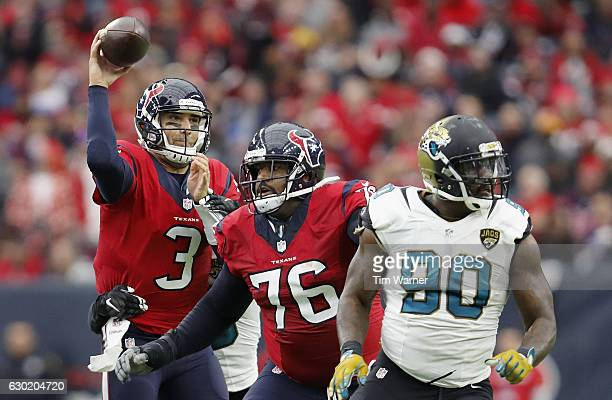 Tom Savage of the Houston Texans throws a pass agains the Jacksonville Jaguars in the second quarter at NRG Stadium on December 18 2016 in Houston...