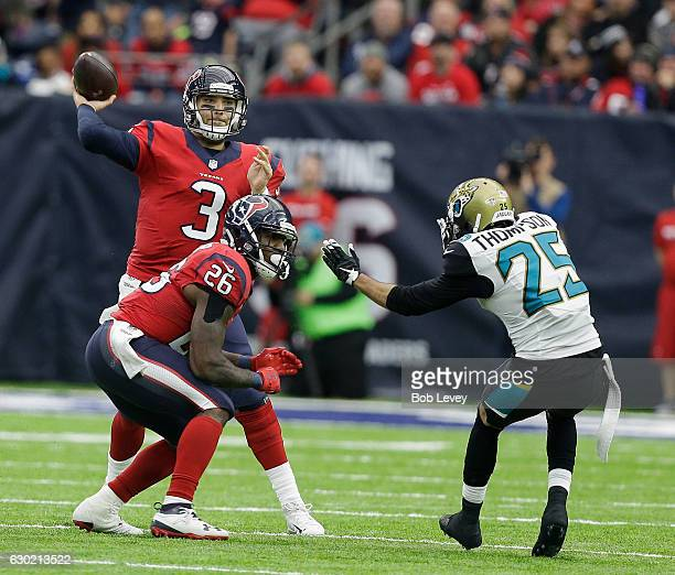 Tom Savage of the Houston Texans throws a pass as he receives a block from Lamar Miller on Peyton Thompson of the Jacksonville Jaguars at NRG Stadium...