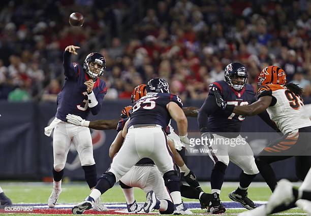 Tom Savage of the Houston Texans throws a pass in the fourth quarter against the Cincinnati Bengals at NRG Stadium on December 24 2016 in Houston...