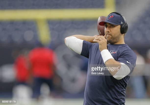 Tom Savage of the Houston Texans warms up before playing the New England Patriots in a preseason game at NRG Stadium on August 19 2017 in Houston...