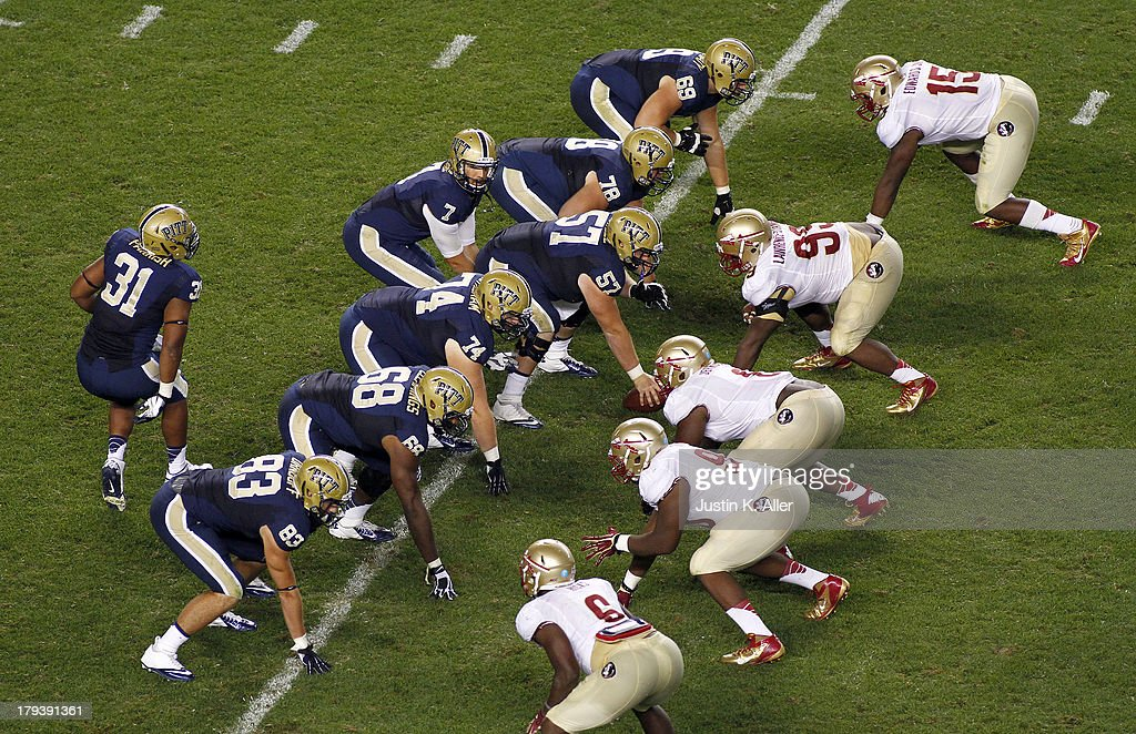 Tom Savage #7 of the Pittsburgh Panthers and the Pittsburgh Panthers line up against the Florida State Seminoles in the second half during the game on September 2, 2013 at Heinz Field in Pittsburgh, Pennsylvania.