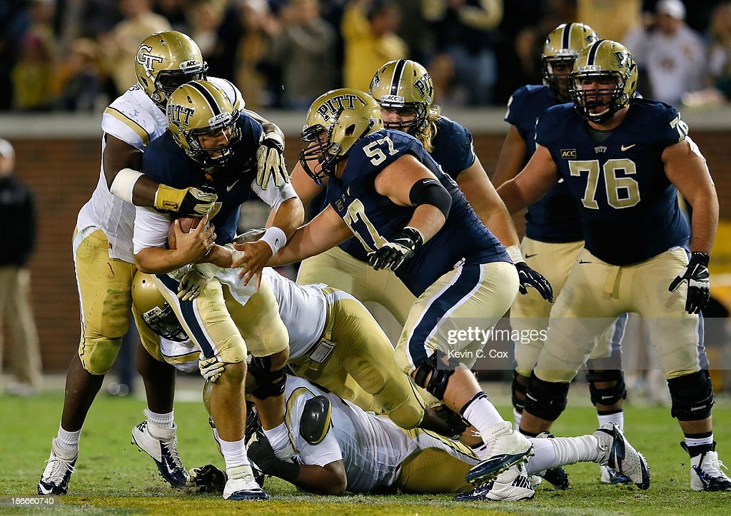 Tom Savage #7 of the Pittsburgh Panthers is sacked by the Georgia Tech Yellow Jackets defense at Bobby Dodd Stadium on November 2, 2013 in Atlanta, Georgia.