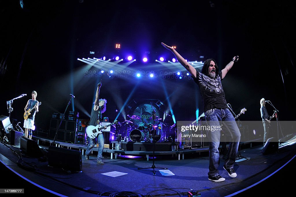 Tom Scholz, David Victor, Tommy DeCarlo, Curly Smith, Tracy Ferrie and Gary Pihl of Boston perform on opening night of their US tour at Hard Rock Live! in the Seminole Hard Rock Hotel & Casino on June 28, 2012 in Hollywood, Florida.