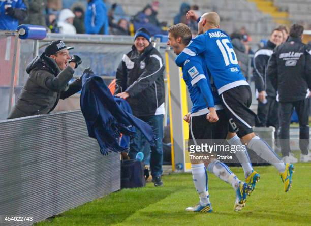 Tom Schuetz Marc Lorenz and Philipp Riese of Bielefeld celebrate during the Second Bundesliga match between Arminia Bielefeld and Dynamo Dresden at...