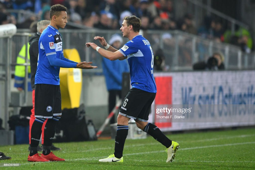 Tom Schuetz (R) of Bielefeld leaves the pitch fr Roberto Massimo during the Second Bundesliga match between DSC Arminia Bielefeld and FC St. Pauli at Schueco Arena on December 1, 2017 in Bielefeld, Germany.