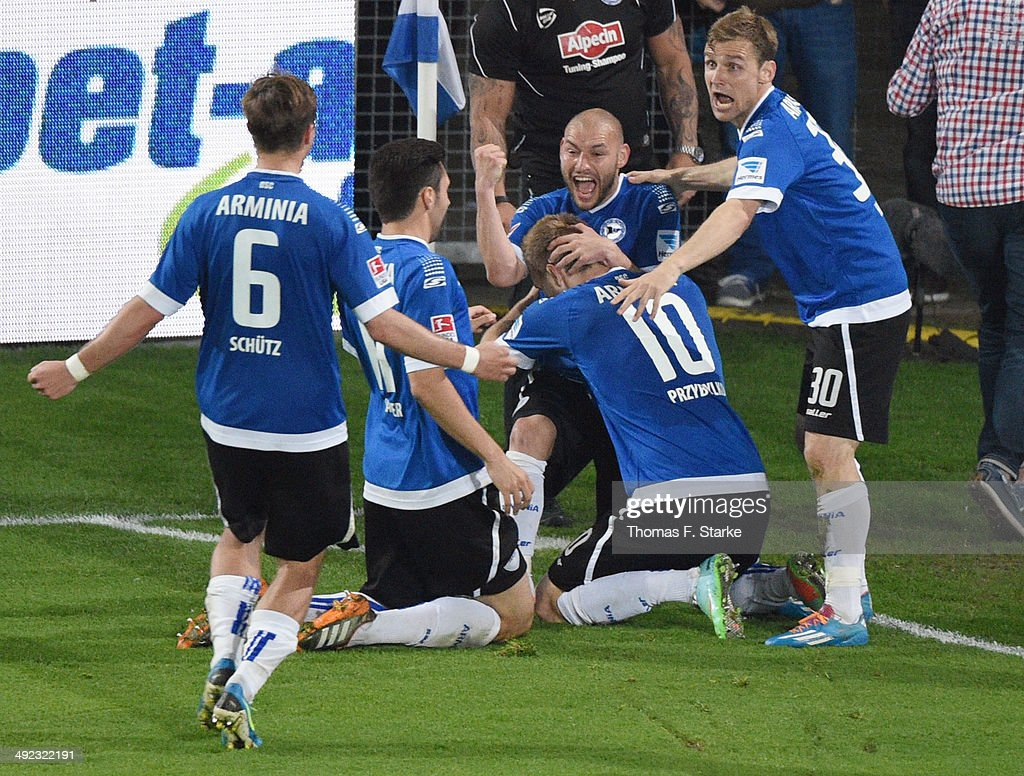 Tom Schuetz, Stephan Salger, Philipp Riese, Kacper Przybylko and Sebastian Hille of Bielefeld celebrate their second goal during the Second Bundesliga Playoff Second Leg match between Arminia Bielefeld and Darmstadt 98 at Schueco Arena on May 19, 2014 in Bielefeld, Germany.