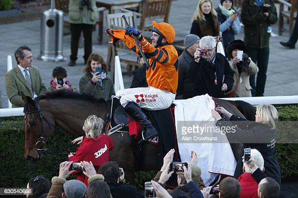 Tom Scudamore celebrates after riding Thistlecrack to win The 32Red King George VI Steeple Chase at Kempton Park on December 26 2016 in Sunbury...