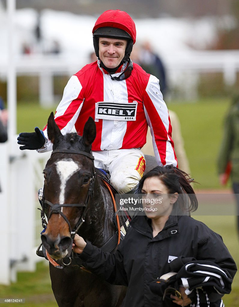 Tom Scudamore rides Monbeg Dude (owned by Mike Tindall) into the winners enclosure after winning the Majordomo Hospitality Handicap Steeple Chase at Cheltenham Racecourse on December 13, 2013 in Cheltenham, England.