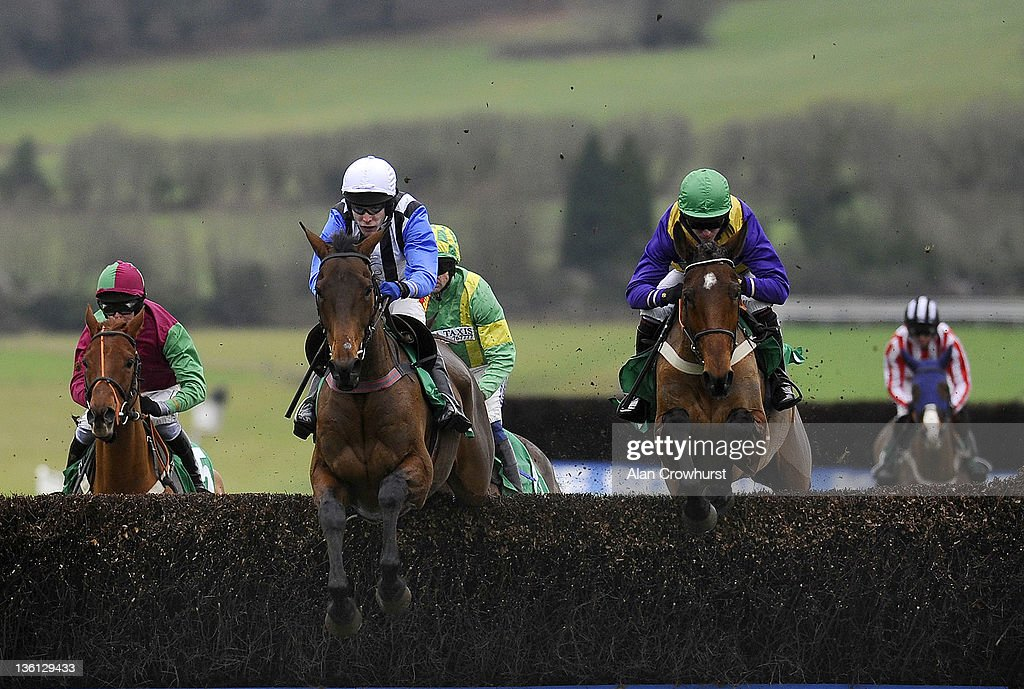 Tom Scudamore riding Alfie Spinner (2nd L) on their way to winning The Text Coral To 60006 For Mobile Betting Beginners' Steeple Chase at Chepstow racecourse on December 27, 2011 in Chepstow, Wales.