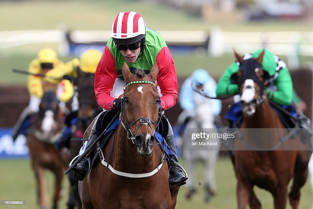 Tom Scudamore riding Conquisto wins in the Scotty Brand Handicap Steeplechase at Ayr racecourse on April 20, 2013 in Ayr, Scotland.