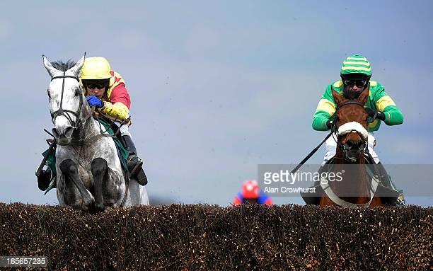 Tom Scudamore riding Dynaste clear the last to win the John Smith's Mildmay Novices' Steeple Chase at Aintree racecourse on April 05 2013 in...