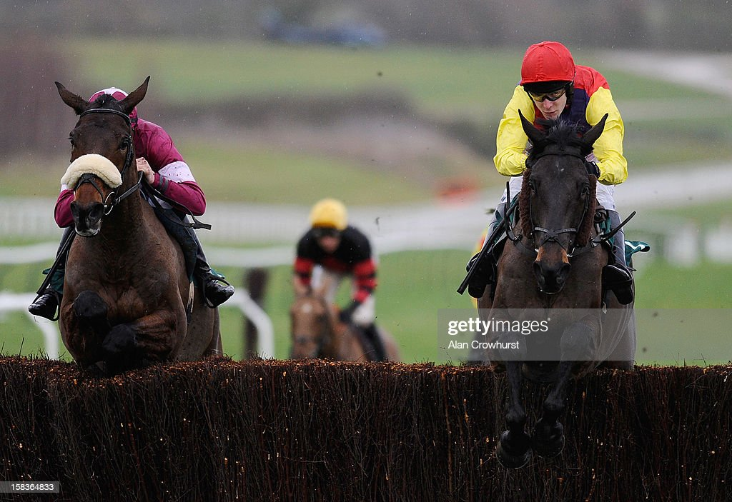 Tom Scudamore riding Master Overseer (R) on their way to winning The Majordomo Hospitality Handicap Steeple Chase at Cheltenham racecourse on December 14, 2012 in Cheltenham, England.