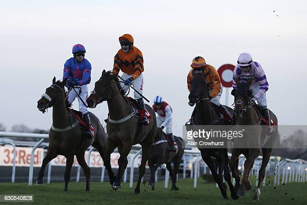 Tom Scudamore riding Thistlecrack celebrates after winning The 32Red King George VI Steeple Chase from Cue Card at Kempton Park on December 26 2016...