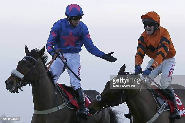 Tom Scudamore riding Thistlecrack celebrates after winning The 32Red King George VI Steeple Chase from Cue Card and Paddy Brennan at Kempton Park on...