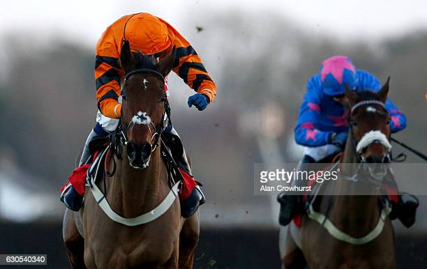 Tom Scudamore riding Thistlecrack celebrates half way up the runin to win The 32Red King George VI Steeple Chase from Cue Card at Kempton Park on...