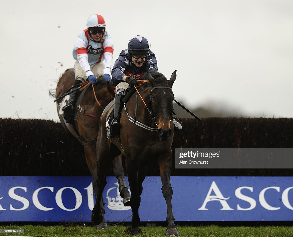 Tom Scudamore riding Wyck Hill clear the last to win The Champagne Bollinger Silver Cup Handicap Steeple Chase at Ascot racecourse on December 22, 2012 in Ascot, England.