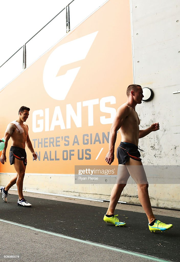Tom Scully and Dylan Shiel of the Giants leave the ground during GWS Giants media and training session at Spotless Stadium on September 21, 2016 in Sydney, Australia.