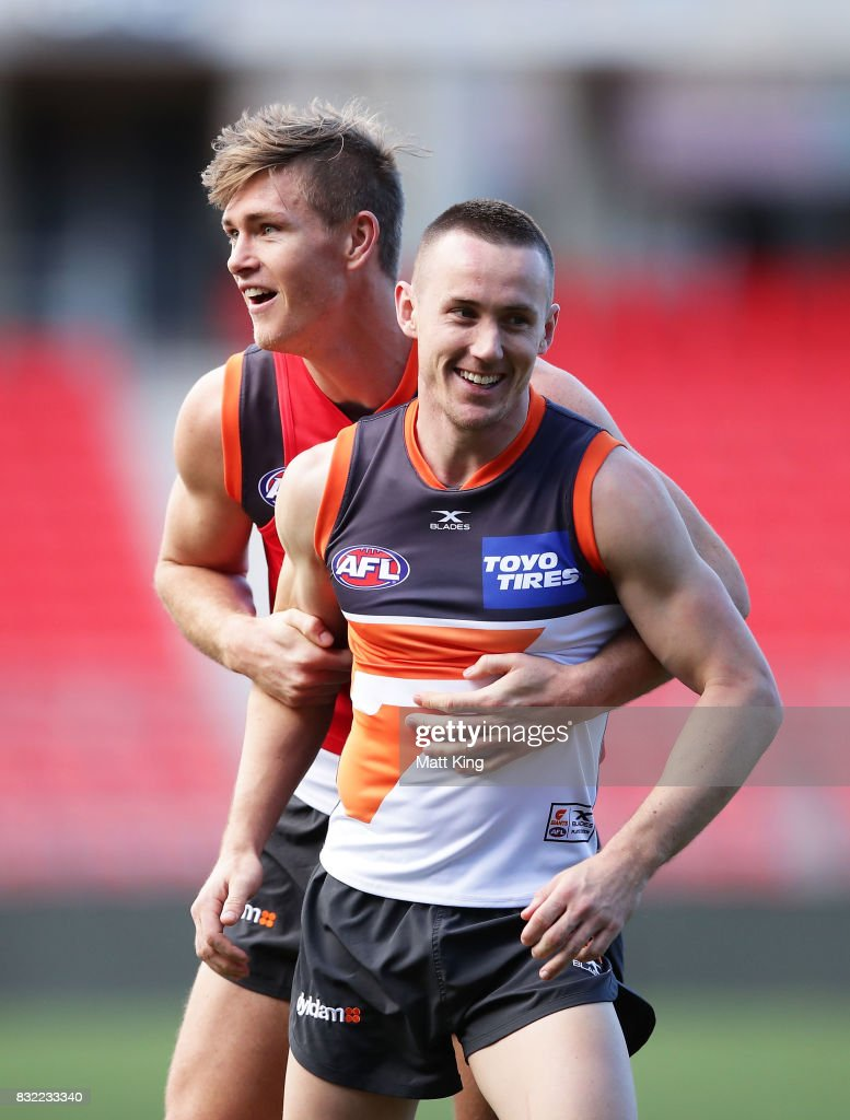Tom Scully (R) is challenged by Adam Tomlinson (L) during a Greater Western Sydney Giants AFL training session at Spotless Stadium on August 16, 2017 in Sydney, Australia.