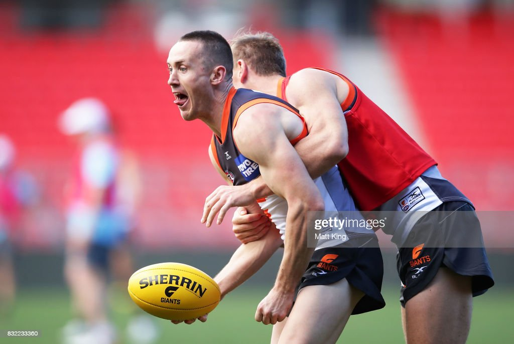 Tom Scully (L) is challenged by Adam Tomlinson (R) during a Greater Western Sydney Giants AFL training session at Spotless Stadium on August 16, 2017 in Sydney, Australia.